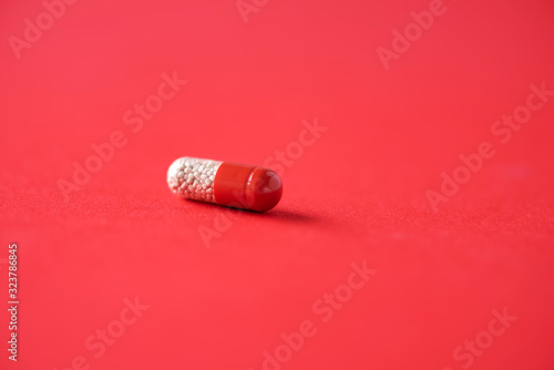 Macro of red capsules on red background Canvas Print