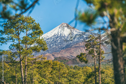 Teide volcano mountain top, Tenerife. Snow capped peak of mount in winter. Pico del Teide, Tenerife, Canary Islands, Spain. Landscape nature outdoor forest background.