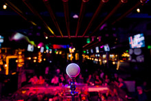 Comedy Microphone On Stage Of Comedy Music Show In Club With Lights And Colors