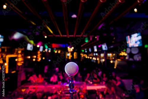 Fotografie, Tablou Comedy Microphone on Stage of Comedy Music Show in Club with Lights and Colors