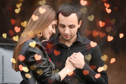 Happy young couple outdoors. Valentine's Day celebration