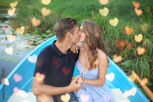 Cute young couple having romantic date in boat