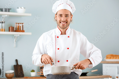 Male chef cooking in kitchen