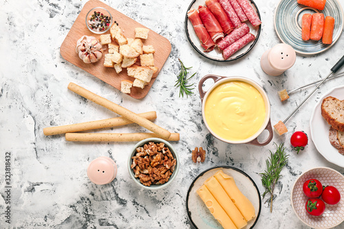 Cheese fondue with snacks on white background