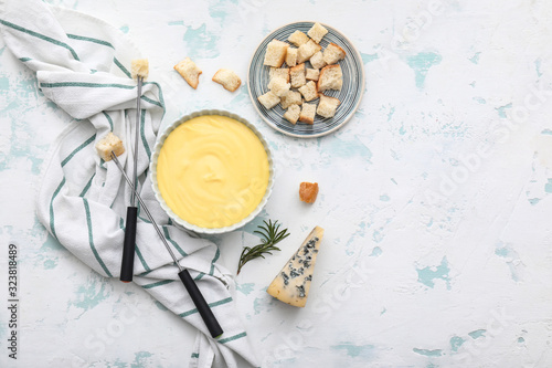 Cheese fondue with croutons on white background