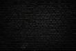 Leinwandbild Motiv Black brick wall as background or wallpaper or texture