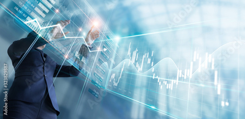 Fototapeta Businessman touching finance growth and graph chart analysing diagram sale data, stock market and currency exchange on virtual interface. obraz