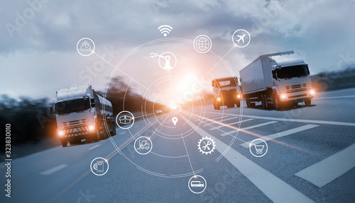 Fototapeta Transportation and Logistics, Truck on motorway and industrial container cargo with icon of network distribution on blue background. obraz