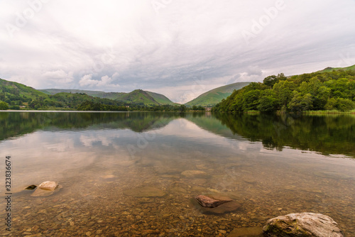 The mountains behind Grasmere reflected in the lake on a beautiful still Autumn day Wallpaper Mural