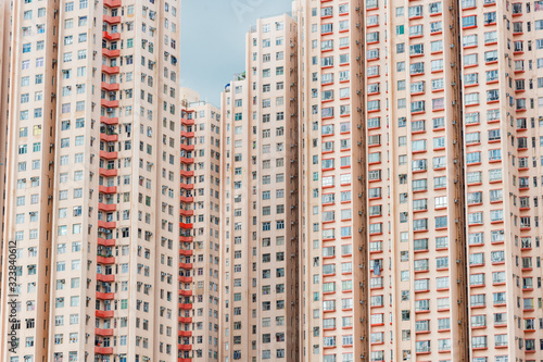 Photo exterior of colorful high rise residential building in Hong Kong city