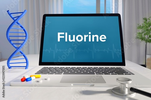 Fluorine – Medicine/health. Computer in the office with term on the screen. Science/healthcare