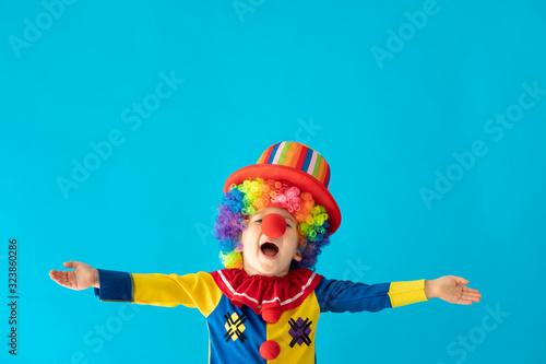 Canvastavla Funny kid clown playing indoor