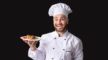 Joyful Chef Holding Plate With Chicken Dish, Studio Shot, Panorama