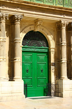 A Green Door In Valletta, Malta. Plaque Next To Door Translates To Ministry For The Family And Social Solidarity.