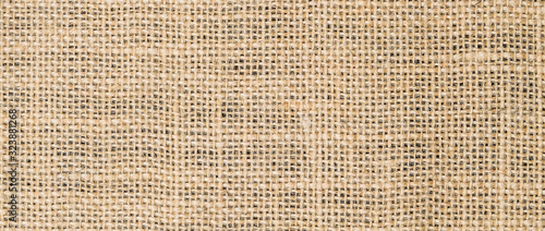 Canvastavla Hessian sackcloth burlap woven texture background/cotton woven fabric background with flecks of varying colors of beige and brown