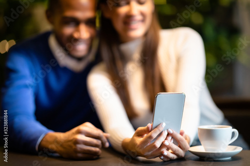 Portrait of afro guy and caucasian girl using cellphone