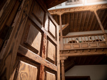 Closeup Image Of Old Wooden Balcony And Heavy Wooden Door At Old House