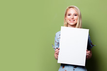 Blonde Woman With White Banner On Green Background
