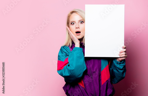Beautiful blonde woman with banner on pink background Tablou Canvas