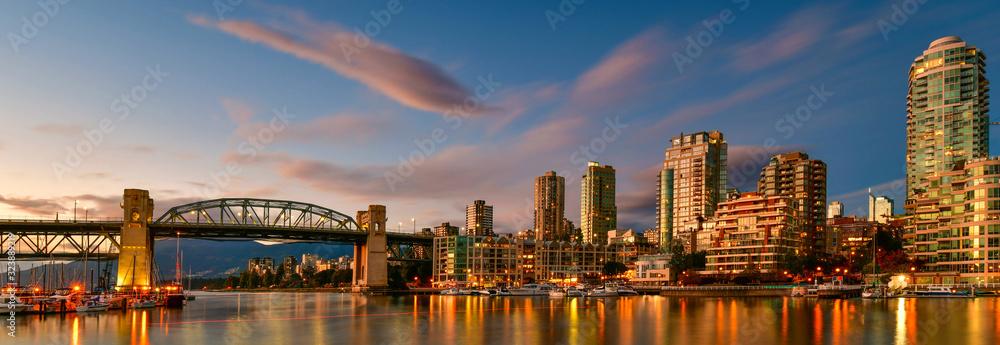 Panorama view Granville island near Burrard Street Bridge at twilight in Vancouver,Canada