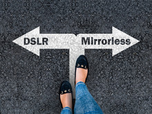 A Woman Steps To A Dslr And Mi...