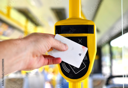 Fotografia Automatic validator for reading and scanning ticket, cards and bank cards in public transport to pay for riding