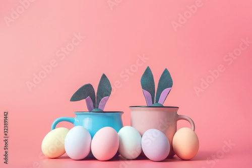 Fototapeta cute and cute easter background with circles from which the ears of the easter bunny peek out next to the easter eggs obraz