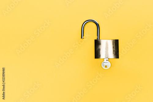 Fototapeta top view of metallic locker and key isolated on yellow obraz