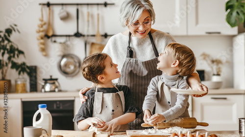 Obraz happy family grandmother and grandchildren cook in the kitchen, knead dough, bake cookies. - fototapety do salonu