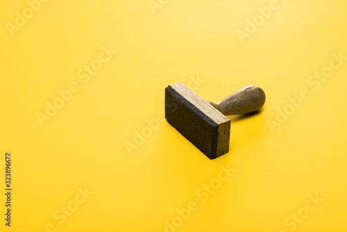wooden stamp on yellow, quality concept
