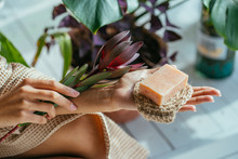 Woman Hands Holding Natural Organic Solid Green Soap Bar Made With Olive Oil On Blue Background. Healthy Lifestyle, Beauty, Skin Care. Zero Waste Home Concept.