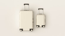 White Luggage Set On White Bac...