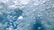 Underwater, bubble pool, water raising towards surface, Close up