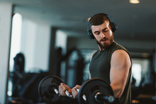 Young Bearded Man Doing Biceps...