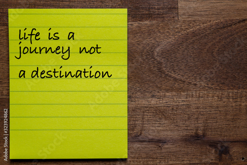 Photo yellow sticker with lines on a dark wooden background with the handwriting of th