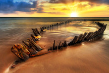 Ship Wreck On The Rossbeigh Beach In Co. Kerry At Sunset, Ireland