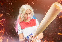 Cosplay Character From The Movie. The Girl  Blonde With A Baseball Bat.