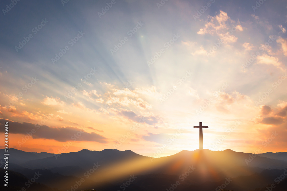 Fototapeta Good Friday concept: cross with sunset in the sky background