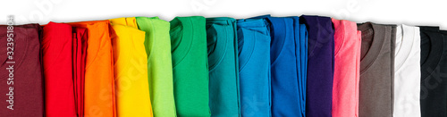 Fotografering wide panorama row of many fresh new fabric cotton t-shirts in colorful rainbow colors isolated