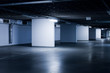 a parking lot inside the apartment building, in the basement. Empty Space in a Parking Lot