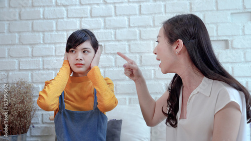 The mother is pointing out the admonition to the daughter, the daughter covering Canvas Print