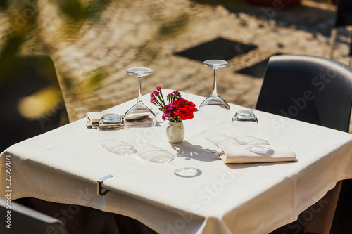 Table Setting Beautiful Decorations In Open Air Table Setting Close Up View Of Restaurant Table With Romantic Place Setting With Red Flowers Plates Cutlery On White Background Romantic Dinner Buy This
