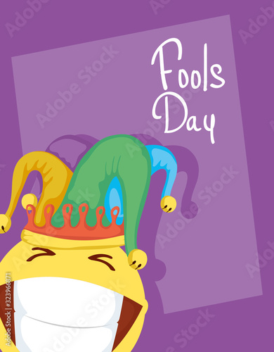 Fotografija happy april fools day card with emoji crazy face and buffoon hat