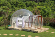 Romantic Bubble House With Transparent Walls. White Wooden Double Bed With Mosquito Net Inside Bubble. Honeymoon In An Inflatable Tent. Tourist Attraction In Tropical Paradise On Bali, Indonesia