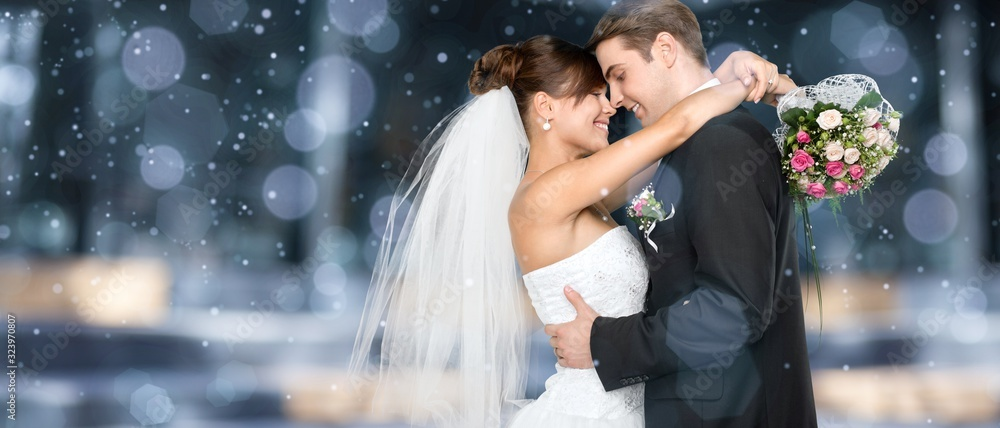 Fototapeta Happy just married young couple on bokeh background
