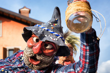 Portrait Of A Masked Man Holdi...