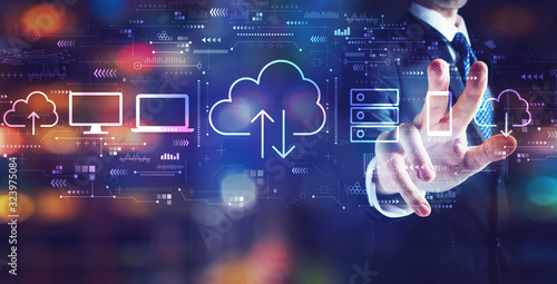 Cloud computing with businessman on night city background