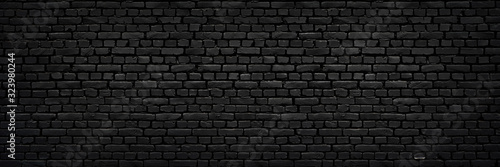 Perfect black brick wall as background or wallpaper or texture - 323980244