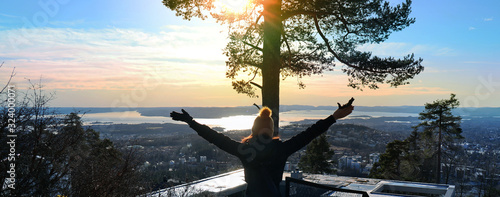 Happy feeling with a view of the City of Oslo, Norway in front Wallpaper Mural