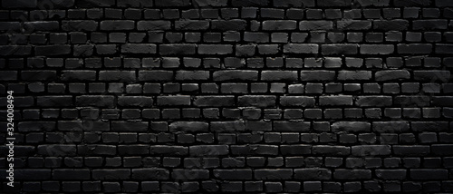 Texture of a perfect black brick wall as background or wallpaper - 324008494